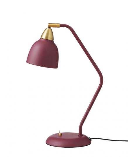 Bordeauxrote Schreibtischlampe.