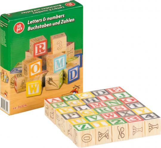 Buchstaben, Zahlen und Motive. Kleine Holzwürfel zum Spielen und Lernen.
